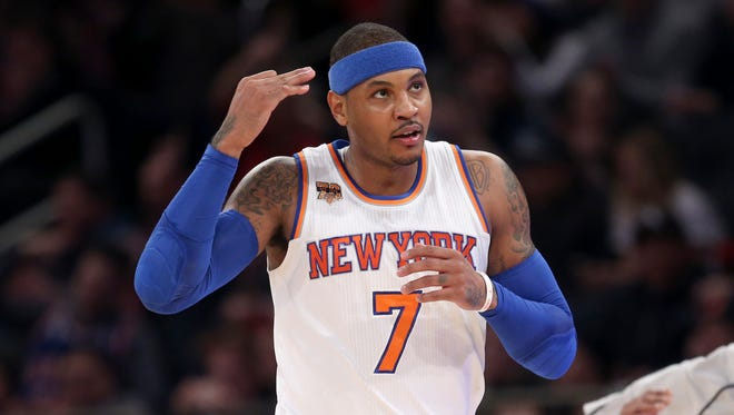 New York Knicks' Carmelo Anthony reacts after hitting a three-point shot during Sunday's game.