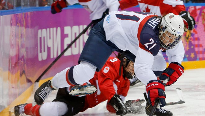 USA Hockey and the women's national team reached an agreement to end a wage dispute on Tuesday night.