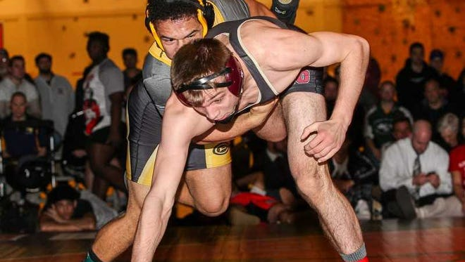 Piscataway's Michael Petite takes down Hillsborough's Kevin Faulkner in the 160-pound Region 5 wrestling tournament final