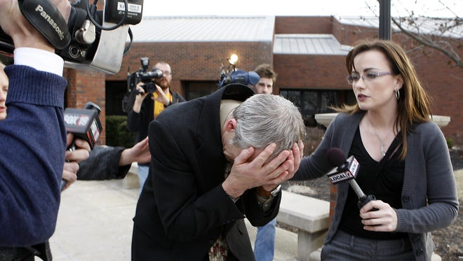 Angenette Levy, right, interviews Gary Widmer, father of Ryan Widmer, as he breaks down after Ryan was found guilty of murdering his wife Sarah Widmer in 2008.