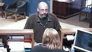 This image taken from surveillance video shows the suspect in the robbery of the Chase Bank branch on Richmond's north side on Wednesday.