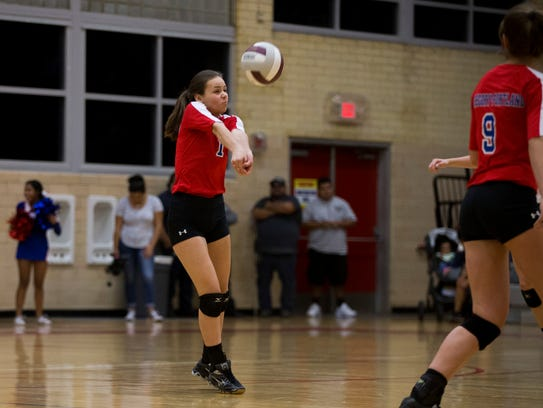 Gregory-Portland's Julianne Saathoff  digs a ball during
