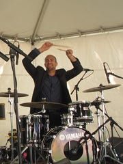 Jared Schonig, drummer for New York City-based The Wee Trio, punctuates an uptempo piece Saturday at the Burlington Discover Jazz Festival in City Hall Park.