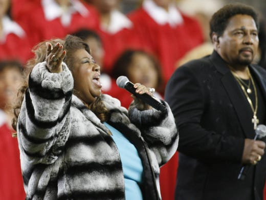 Aretha Franklin along with Aaron Neville sing the National
