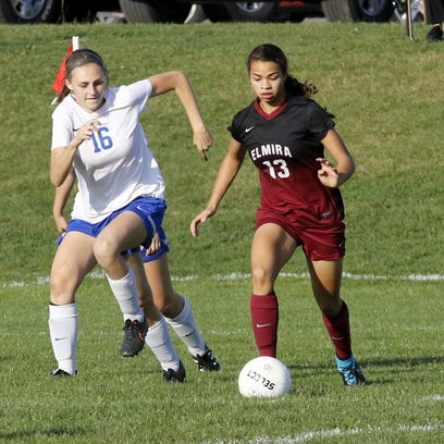 Elmira's Kendra Oldroyd tries to keep control as Abby Clark of Horseheads defends during a 1-1 girls soccer tie Thursday at Horseheads.