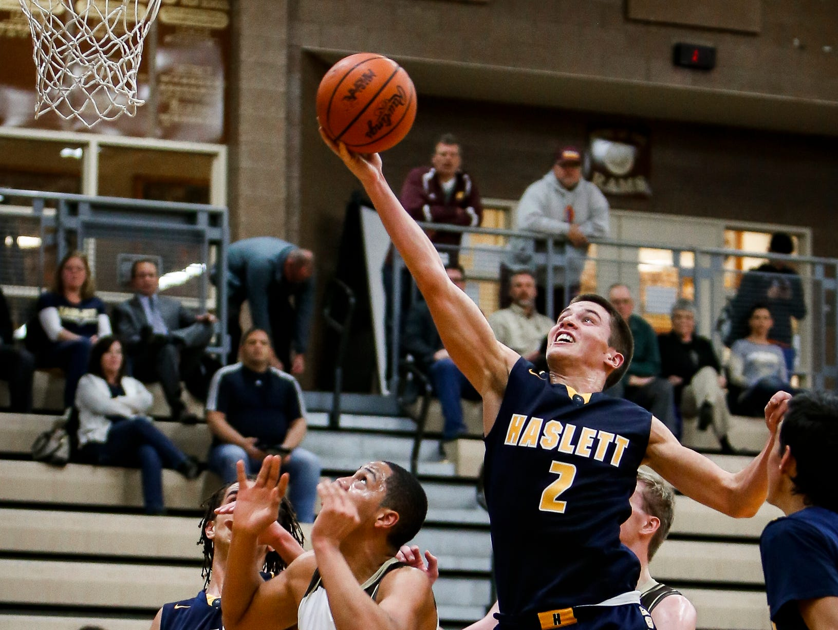 Haslett senior Evan Block drops in two from the paint against Holt Tuesday, Jan. 24, 2017, at Holt. Holt won 62-44.