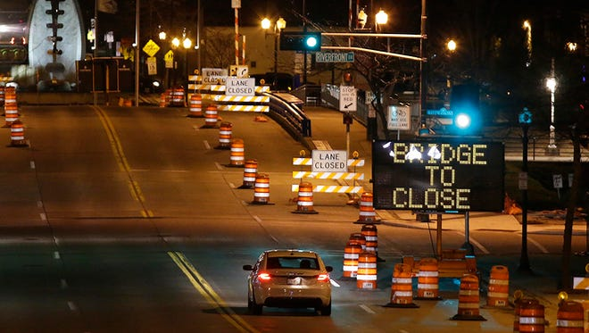 A vehicle operates on the south bound lane of South 8th Street, Thursday, April 12, 2018, near signs that the bridge will be closing for repairs.  According to the City of Sheboygan, South 8th Street will be closed April 16, 2018 and April 17, 2018, between Indiana Avenue and Riverfront Drive, for bridge repairs.