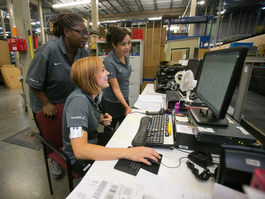 Clockwise from left, Cynthia Foote and Zully Garcia, both packing supervisors; and Katie Brozena, packing manager, checks items at Macy's-Bloomingdale's online order-fulfillment center in Goodyear on Wednesday.
