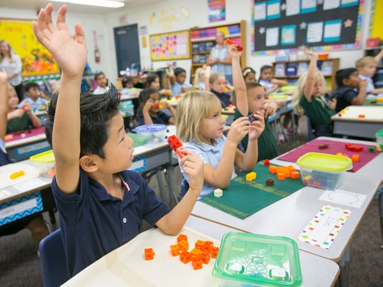 Student Matthew Lee, 5, participates in a math drill during a class at Valley Academy in Phoenix.