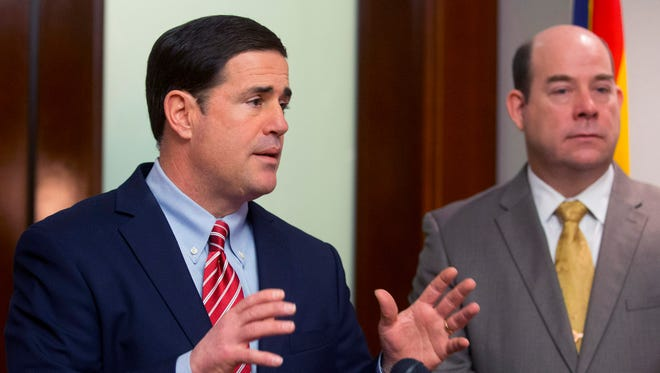 Gov. Doug Ducey outlines his budget at the Executive Tower in Phoenix on Jan. 16, 2015.