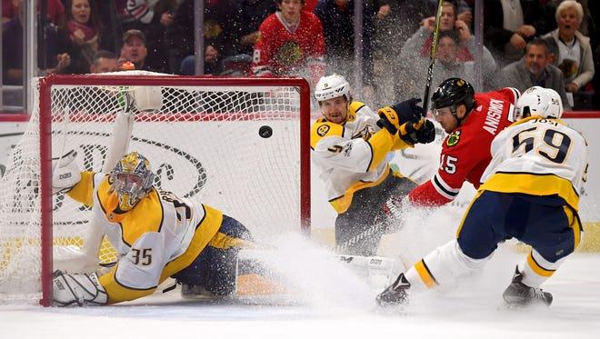 Blackhawks center Artem Anisimov scores a goal against Predators goalie Pekka Rinne on Friday at United Center.