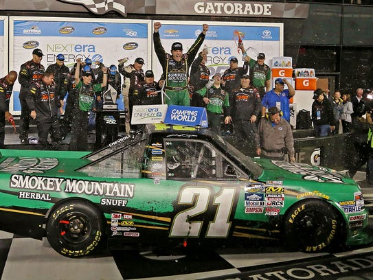 Johnny Sauter, center, celebrates with his team after