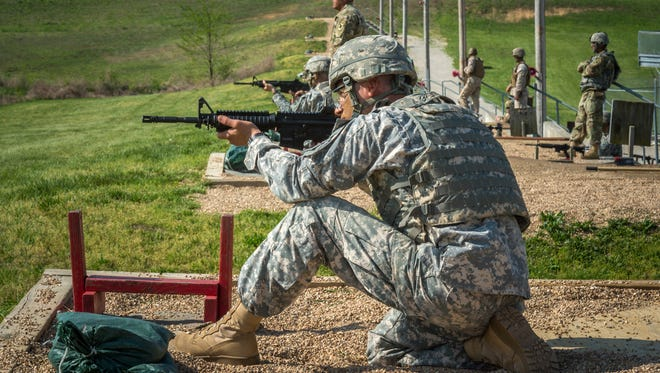 Sgt. 1st Class Alvaro Madrigal engages targets during the M4 firing portion of the 2016 Maneuver Support Center of Excellence and Fort Leonard Wood Best Warrior Competition.