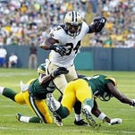 New Orleans Saints' Tim Hightower runs during the first half of an NFL preseason football game against the Green Bay Packers on Thursday.