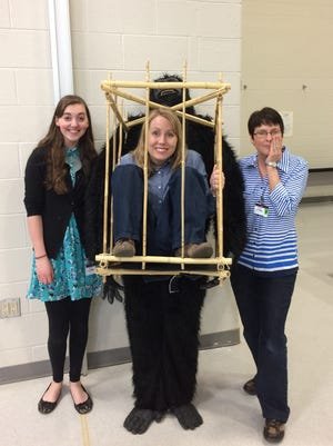 Author Sherri Maret, right, visits Shippensburg Area Intermediate School in May 2016. Noelle Ziegler, left, illustrated Maret's first book.Beth Jones, SAIS librarian,is in the cage.