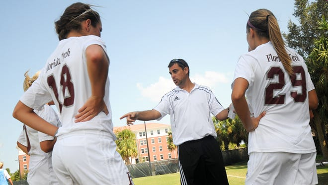 Dustin Smith works with members of the Florida Tech women/s soccer team.