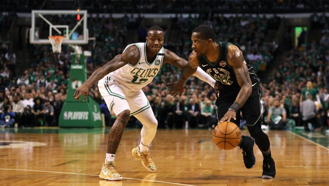 Terry Rozier  of the Boston Celtics defends Eric Bledsoe of the Bucks  on Tuesday night in Game 2 of the team's first-round NBA playoff series.
