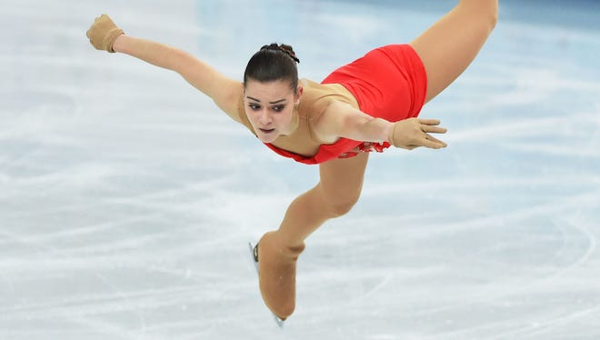 Adelina Sotnikova of Russia emerged from her 15-year-old teammate's shadow to stand second after the women's short program.