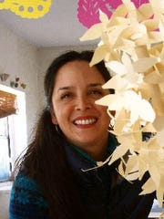 El Paso artist Margarita Cabrera with a model of her sculpture UPLIFT.