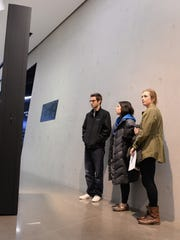 MSU students look at Anti-Debt Monolith which is one of the one of the pieces of art in the Day After Debt exhibition which is at the Broad Art Museum on the MSU campus. Photo taken 11/25/2014 by Greg DeRuiter/Lansing State Journal