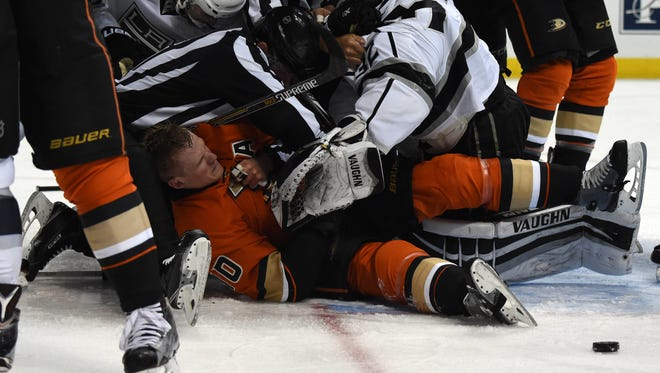 Los Angeles Kings goalie Jonathan Quick (32) and Anaheim Ducks right wing Corey Perry (10) fight in the first period during an NHL game at Honda Center.