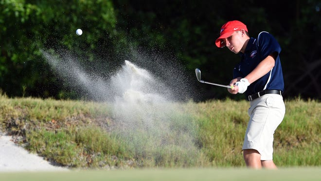 St. Lucie West Centennial High School's Alejandro Meek hits out of a green-side bunker on the sixth hole Tuesday, Sept. 19, 2017, during a match at Indian Hills Golf Club in Fort Pierce.