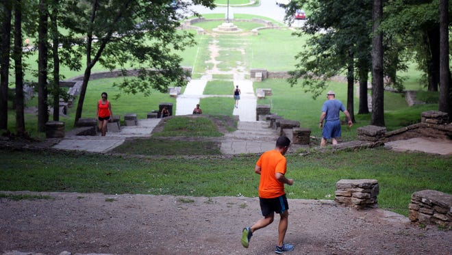 People get a work out climbing up and down the stone steps that lead to the trails within Percy Warner Park in Belle Meade Monday, August 8, 2016.