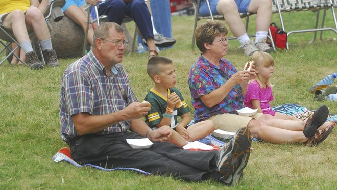 Guests enjoy the food while watching the entertainment at the weekly Heart of Wisconsin Chamber of Commerce Lunch by The River. The event offers food and entertainment every Thursday (weather permitting) starting June 11 through Aug. 27.