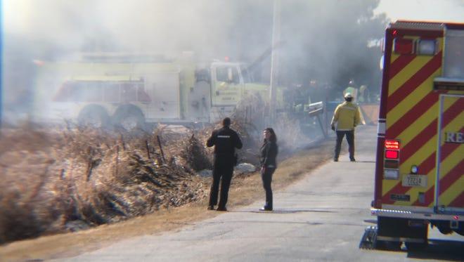 Crews on Wednesday battle a barn fire outside of Mosinee, Wis.