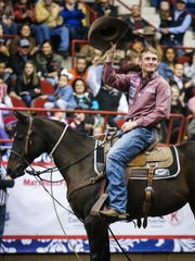 Tuf Cooper greets the audience after his run in tie down during the 6th performance of the San Angelo Stock Show and Rodeo Saturday, Feb. 10, 2018, at Foster Communications Coliseum.