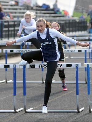 Granville junior Ciahnna Winston competes in the 100 hurdles last week at the Zanesville Wayne Clark Invitational