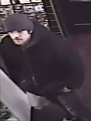 Livonia police say this man is suspected of taking several video game systems from the Gameplay shop at the Livonia Marketplace shopping center.