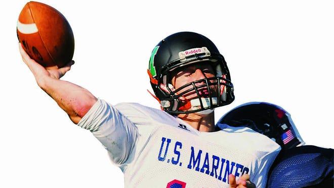 Leathernecks quarterback C.J. Gatt of Montgomery throws in the first half of Thursday night's Basilone Bowl football game.