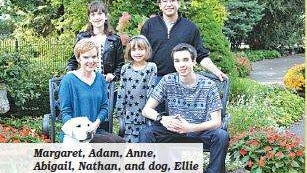 MArgaret, Adam, Anne, Abigail, Nathan, and their dog Ellie pose for a photo.