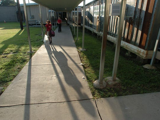 Students walk to temporary classrooms at Evangeline