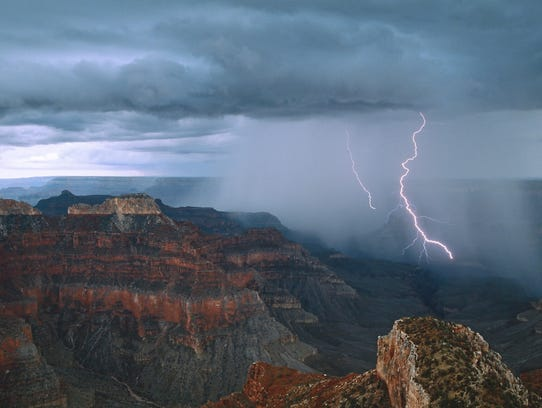 Lightning arcs into the Grand Canyon's depths near