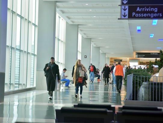 Passengers arrive at McGhee Tyson Airport in December