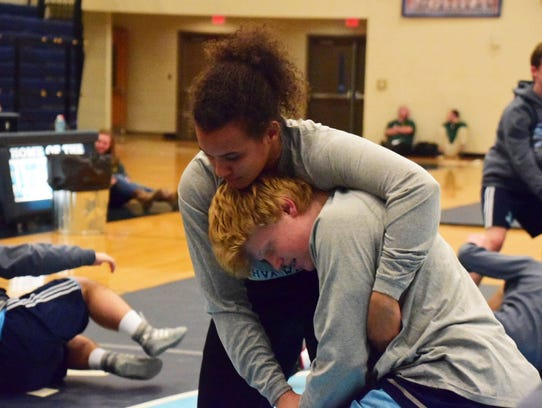 Kenya Sloan, a senior and team captain, trains with