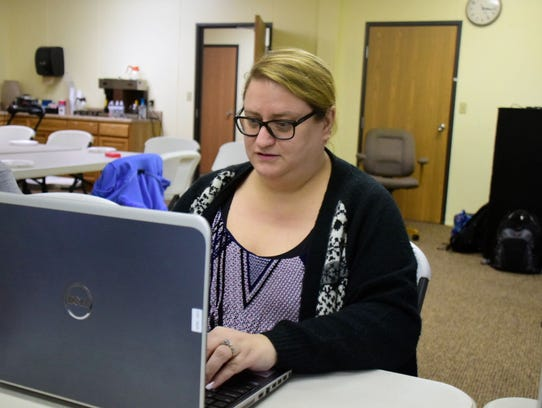 Jennifer Holt concentrates on finding clues on the