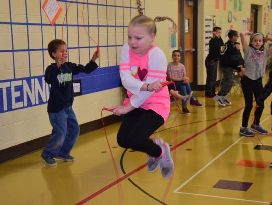 Libby Meridieth, 10, shows off her fancy jump roping
