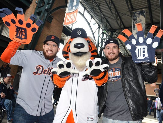 Detroit Tigers fans  Elpidio Sancen, left, and his