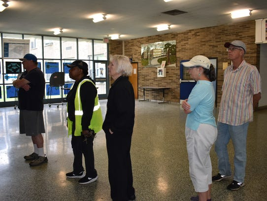 A line of residents wait to vote at the polling site