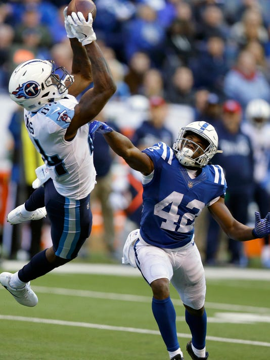 Tennessee Titans' Corey Davis (84) makes a catch against Indianapolis Colts' Kenny Moore (42) during the second half of an NFL football game, Sunday, Nov. 26, 2017, in Indianapolis. (AP Photo/Michael Conroy)