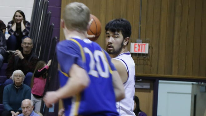 Dryden senior forward Ali Abel-Ferretti faces down Trumansburg's Austin Grunder in a conference game this season.