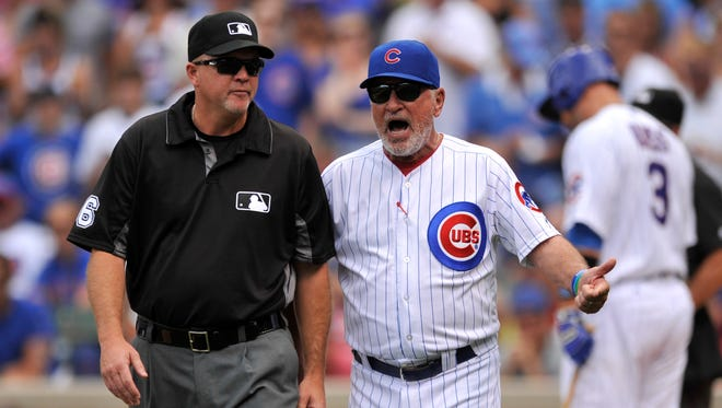 Chicago Cubs manager Joe Maddon, right, argues with second base umpire Ron Kupla, left, after Maddon was ejected by home plate umpire Jerry Meals while Maddon was arguing a strike call on Cubs' David Ross during the second inning of a baseball game against the Cincinnati Reds, Tuesday, July 5, 2016, in Chicago.