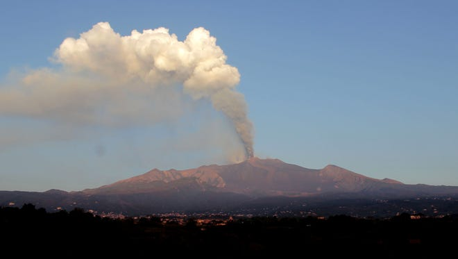 Smoke billows during an eruption of Mount Etna volcano near the Sicilian town of Catania, Italy, on Oct. 26, 2013.