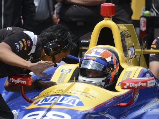 IndyCar driver Alexander Rossi talks with a crew member before qualifying for the 100th running of the Indianapolis 500 on Saturday, May 21, 2016 at the Indianapolis Motor Speedway.