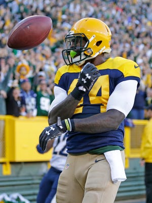 Green Bay Packers running back James Starks (44) tosses the ball in celebration after he scored on a 65 yard run in the first quarter against the San Diego Chargers at Lambeau Field.