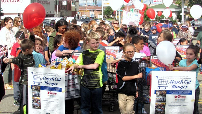 School children prepare to take part in the annual March Out Hunger event Tuesday on Elmira's Southside.