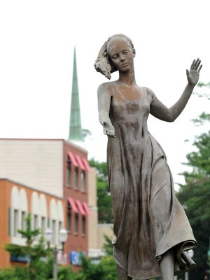 Andromeda, by artist Anthony Frudakis, a statue in downtown East Lansing on Grand River.